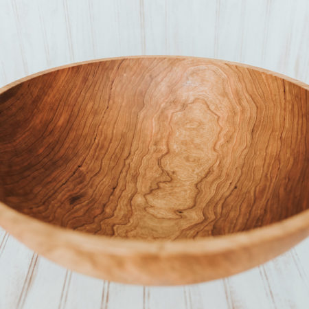 A 20-inch diameter solid cherry bowl