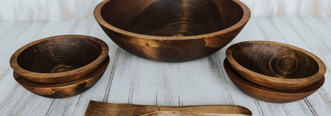 A wooden bowl set in Beech wood with a dark walnut finish.