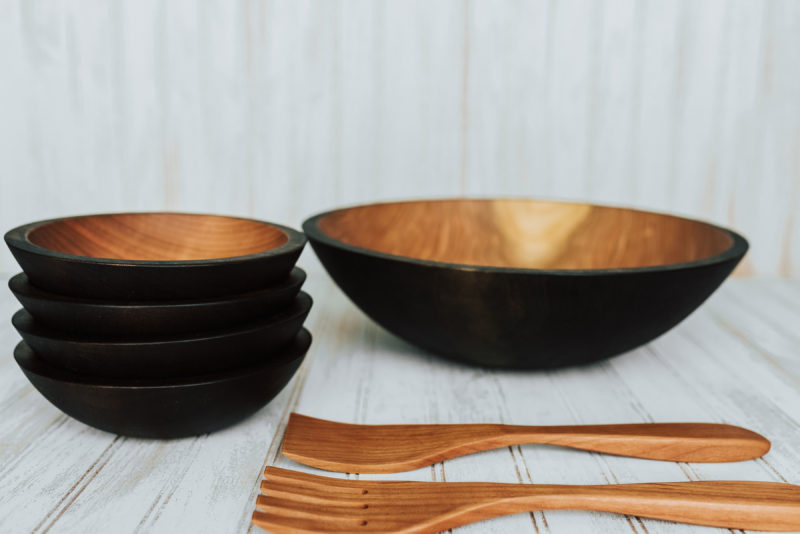 Every five-bowl Ebonized Cherry wooden dish set comes with a 15-inch serving bowl, (4) 7-inch side salad bowls, and a set of 12-inch servers.