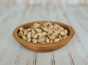 7-inch Beech Side Salad Serving Bowl filled with pistachios