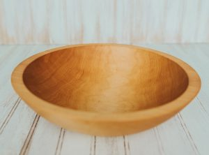 A 12-inch diameter solid maple bowl