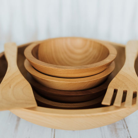 15 inch Beech wood bowl set with four small bowls and two utensils.