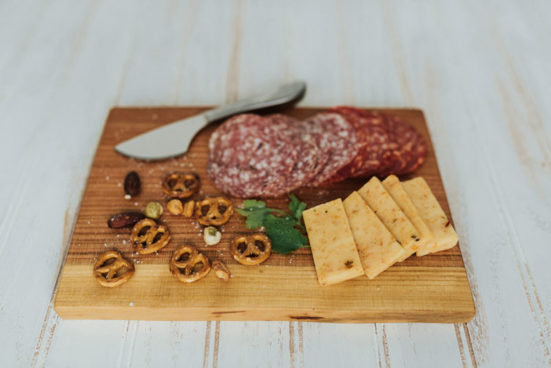 A charcuterie display on a Holland Bowl Mill cutting board. Part of a line of great corporate gift ideas.