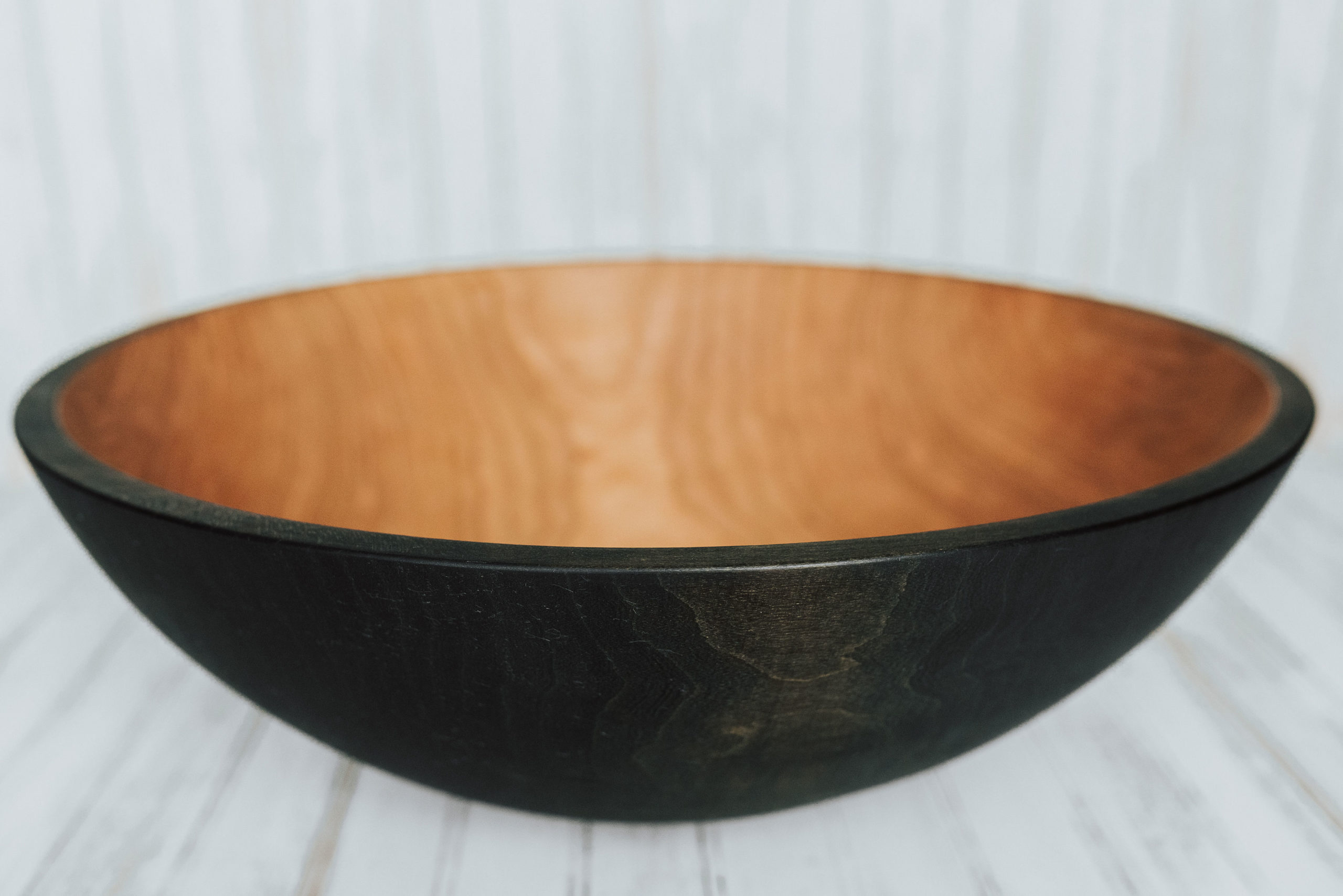 A 20-inch ebonized wooden bowl from the Holland Bowl Mill