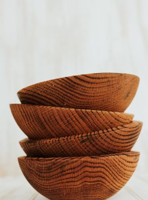 7 inch torched red oak bowls in a stack.