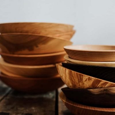 A group of decorative wooden bowl stacks.