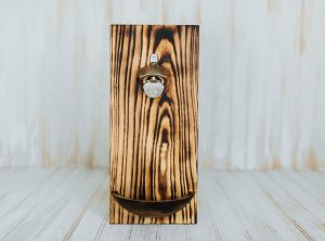 Wooden wall mounted bottle opener with an attached Torched Red Oak bowl.