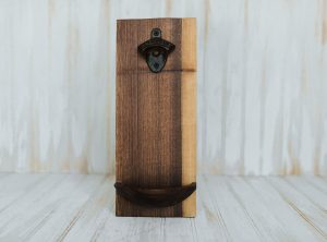 Wooden Wall mounted bottle openers in a walnut finish.