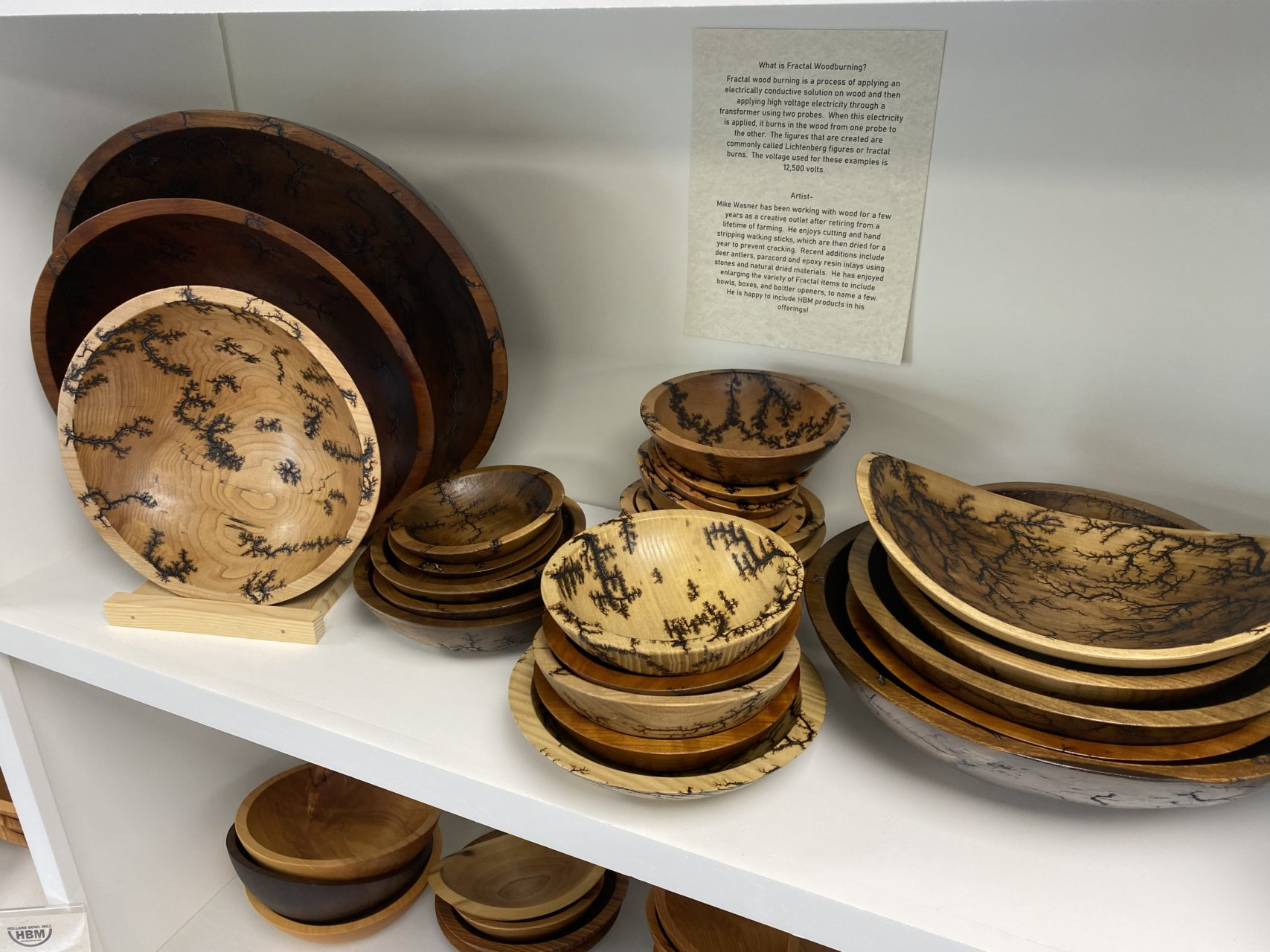 Fractal wood burning bowls on display in the Holland Bowl Mill showroom.