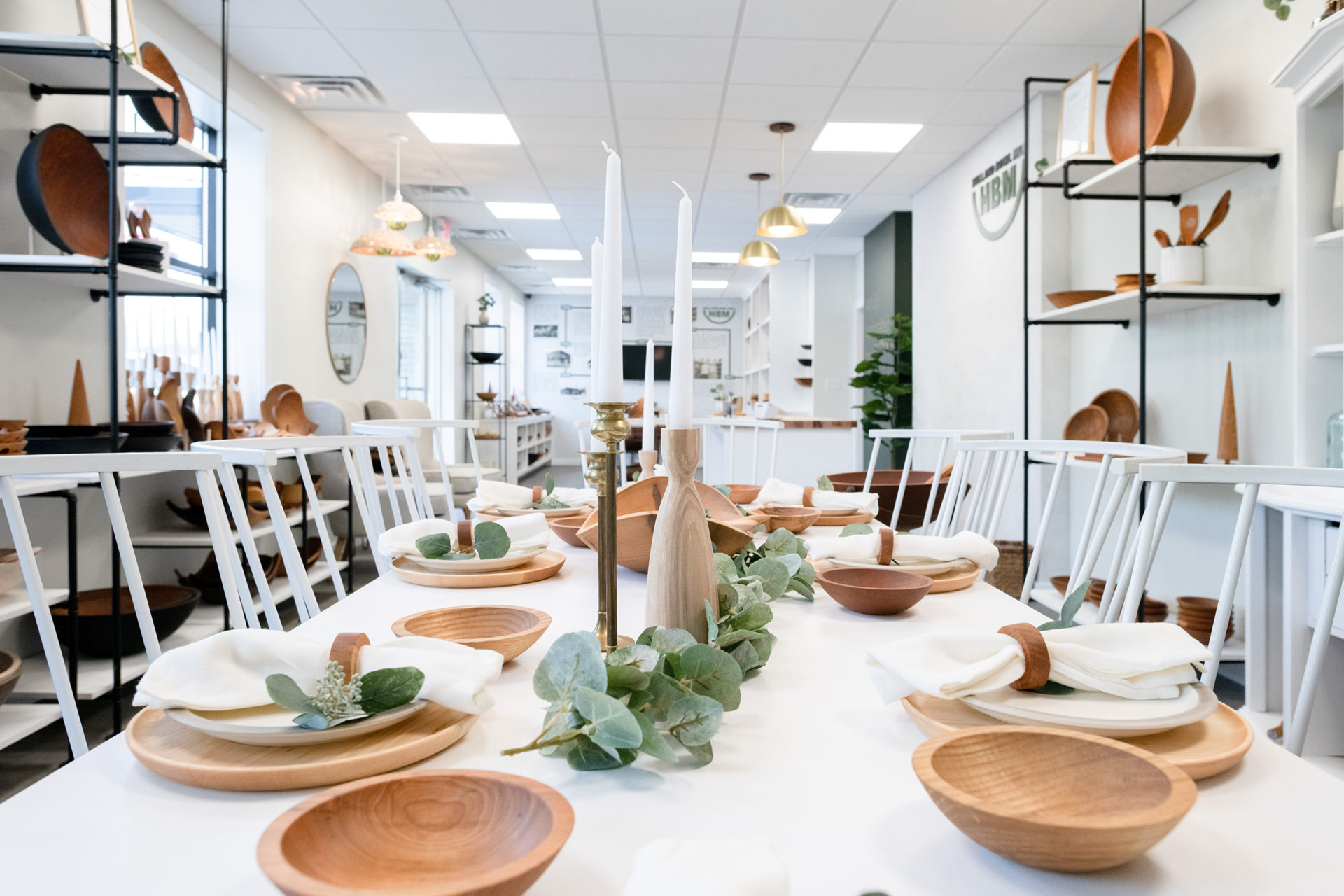 Get to know the many benefits of wooden dishes. A full table spread of wooden wares in the Holland Bowl Showroom