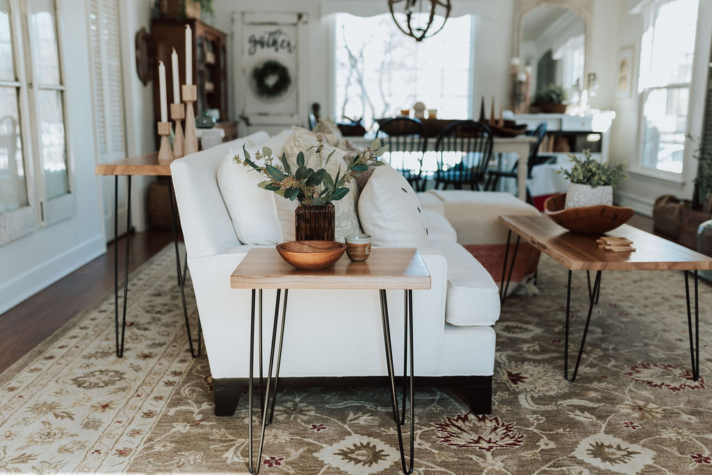 The Holland Bowl Mill has a new line of natural wood furniture, including coffee tables, end tables, console tables, and entryway benches. The interior of an upscale Grand Rapids home with all three main natural wood tables in a living room setting.