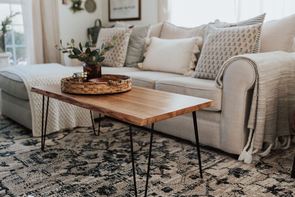 Wooden furniture designed by the Holland Bowl Mill. A wooden coffee table with hairpin legs.
