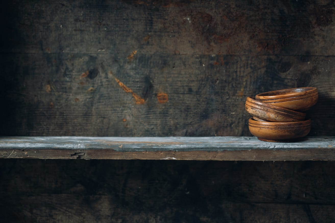 Old wooden bowl on a shelf.
