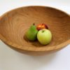 Wooden Bowl with fruit inside. Wooden bowl care is important.