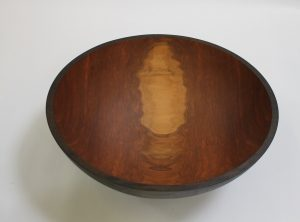 An ebonized large cherry bowl: 20""