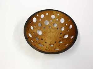Ebonized wooden fruit bowl