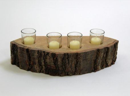 A 4 piece wooden candle holder