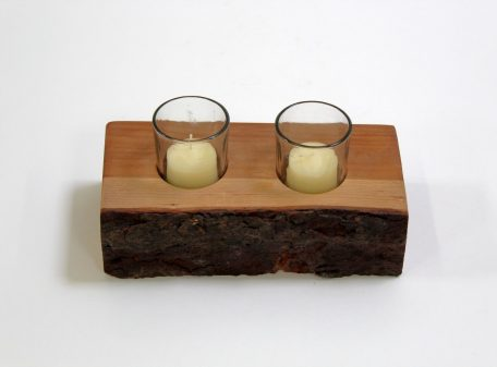 A small wood plank candle holder